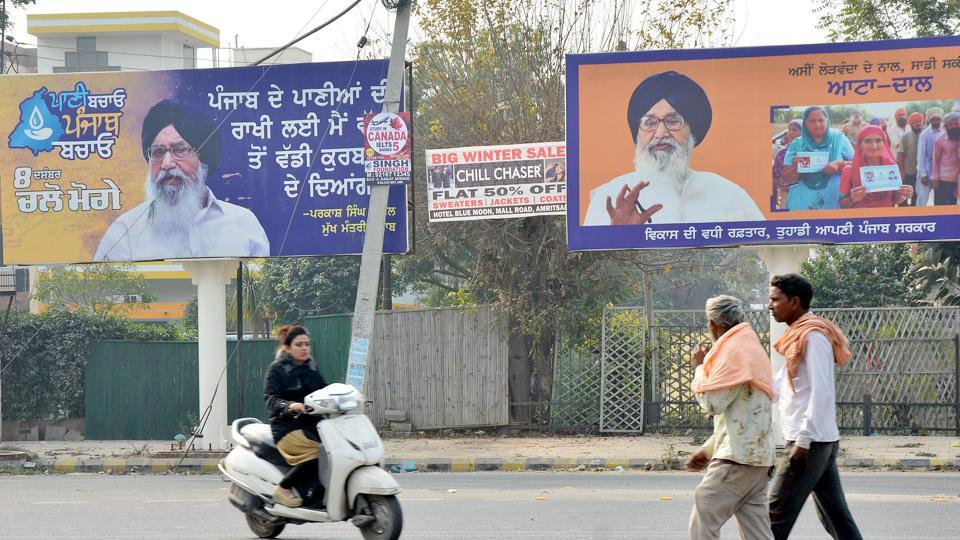 Hoardings by Punjab's ruling SAD party can be seen at Ranjeet Avenue in Amritsar.