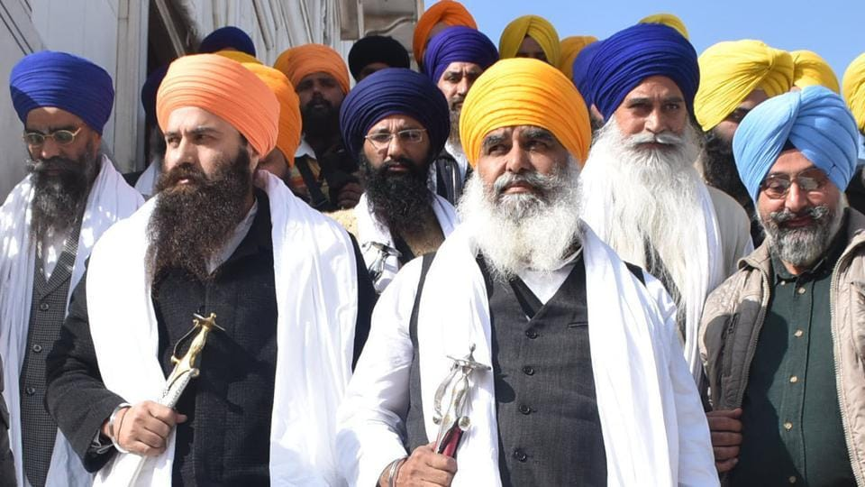 Radical jathedar Dhian Singh Mand (centre) with others at the Golden Temple in Amritsar on Monday.