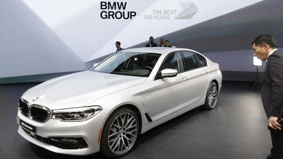 The German luxury automaker displayed a plug-in hybrid version of the car, the BMW 530e, for the first time in Detroit.  Like its competitors, the 5-series is losing ground to SUVs - and the Tesla Model S electric sedan - among affluent US buyers.  (AP)