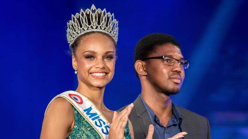 Miss Guyana 2016 and newly elected Miss France 2017 Alicia Aylies (L) smiles on stage during a show on January 9, 2017 in Cayenne on the French department of Guiana (Guyane).  (Jody amiet / AFP)