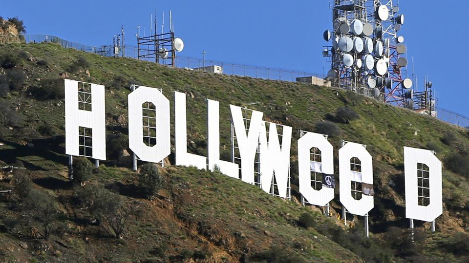 The famed Hollywood sign is seen altered to read
