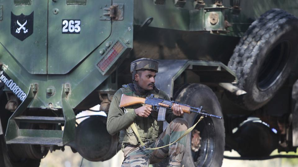 A soldier takes position outside a General Reserve Engineer Force camp in Akhnoor sector, near Jammu, where three civilians were killed in a militant attack.