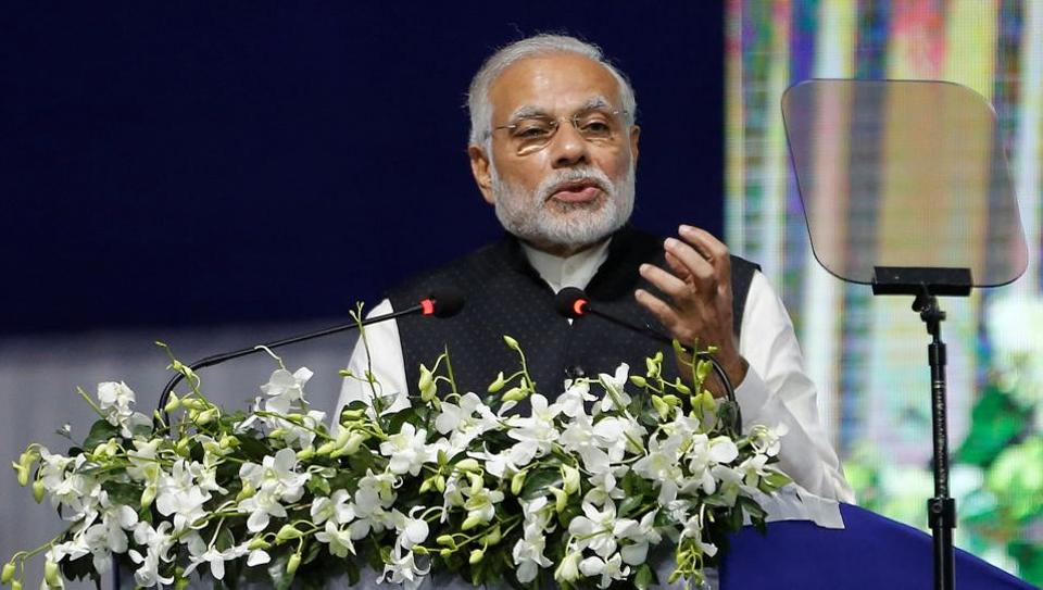 India's Prime Minister Narendra Modi delivers a speech after he inaugurated the country's first international exchange - India INX in Gujarat International Finance Tec-City (GIFT) in Gandhinagaron January 9.
