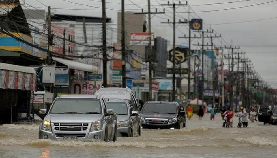 Cars drive through a flooded street at Muang district in Nakhon Si Thammarat province, southern Thailand, January 6, 2017.