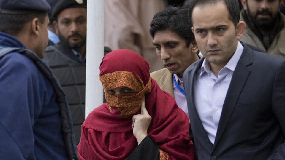 The wife of a judge, accused of torturing her 10-year-old maid, outside the Supreme Court in Islamabad, Pakistan.