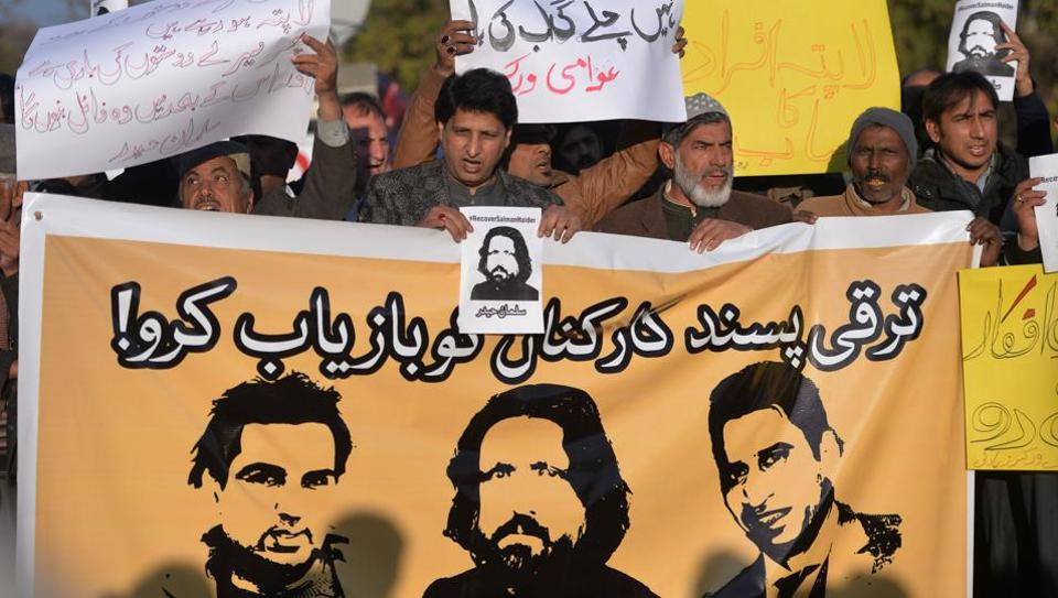 Pakistani human rights activists hold images of bloggers who have gone missing during a protest in Islamabad on January 10, 2017. Human Rights Watch on January 10, 2017 asked Pakistan to urgently investigate the apparent abductions of four bloggers who campaigned for human rights and religious freedom, saying their near simultaneous disappearances raised concerns of government involvement.
