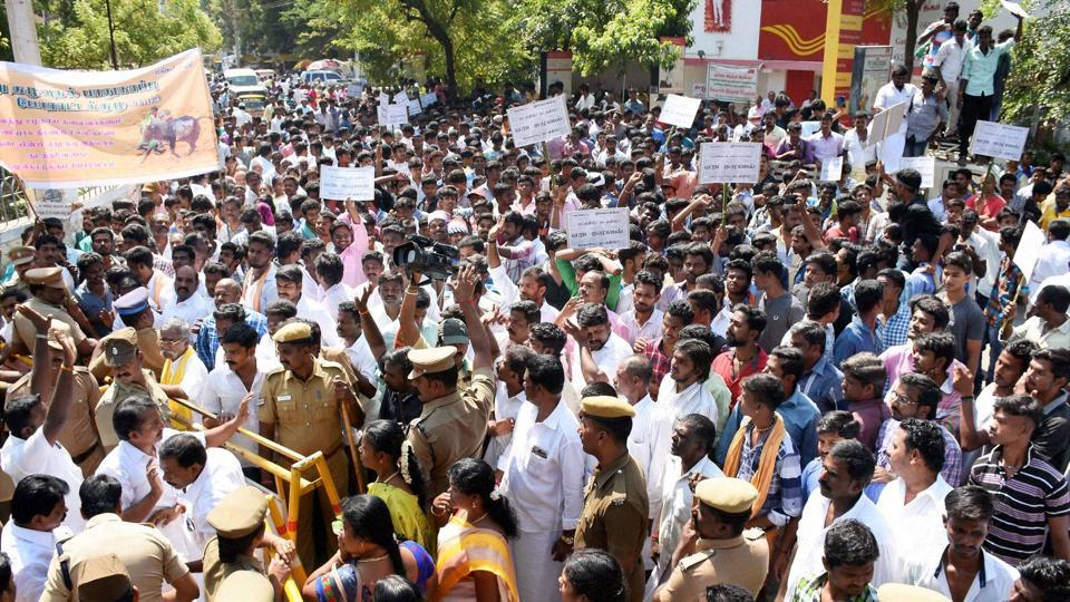 People holding a protest demanding revocation of ban on Jallikattu in Madurai on Monday.