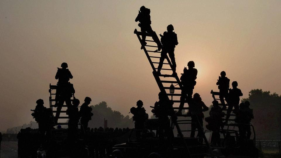 NSG Commandos during the rehearsal ahead of the Republic Day parade in New Delhi.