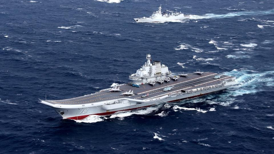 China's Liaoning aircraft carrier with accompanying fleet conducts a drill in an area of South China Sea.