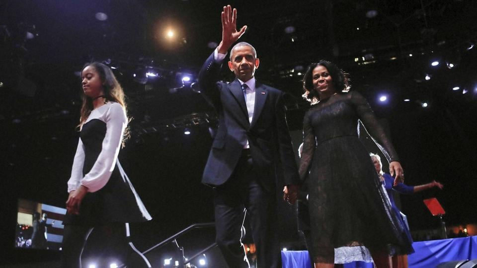 President Barack Obama waves on stage with First Lady Michelle Obama and daughter Malia after the presidential farewell address at McCormick Place in Chicago on Thursday.