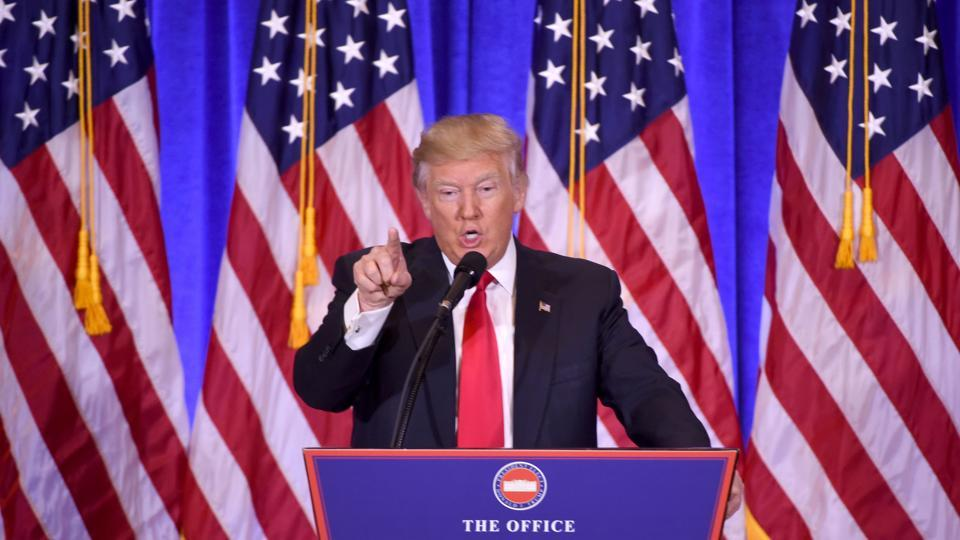 US President-elect Donald Trump answers journalists questions during a press conference.