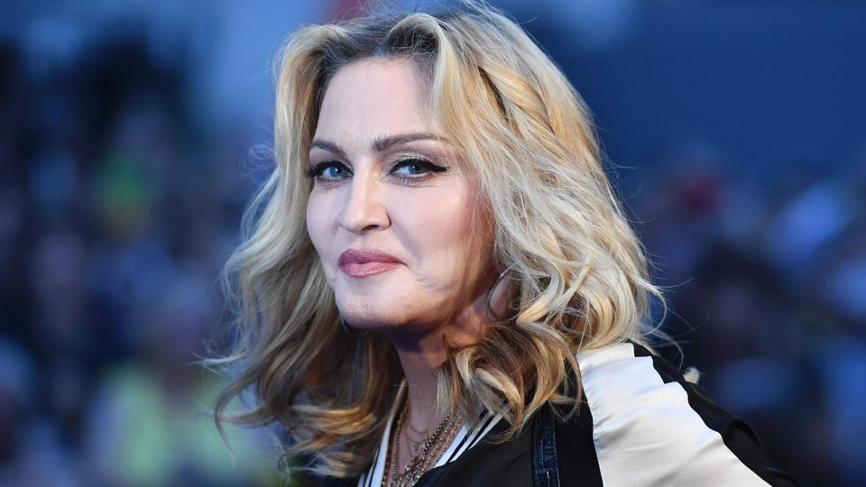 Madonna poses arriving on the red carpet to attend a special screening of the film The Beatles Eight Days A Week: The Touring Years in London.