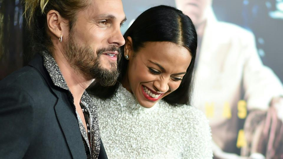 Artist Marco Perego and actor Zoe Saldana arrive for the for the world premiere of Warner Bros. Live By Night.