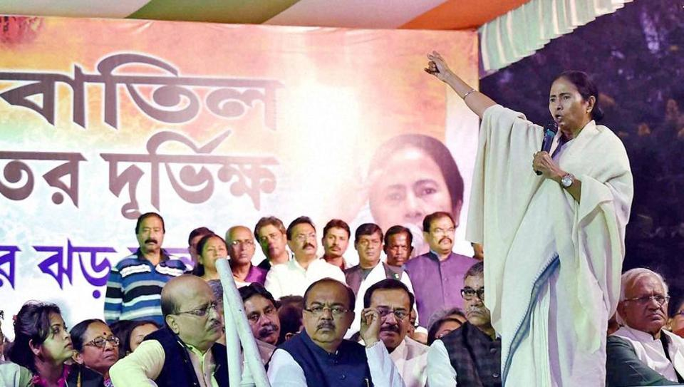 TMC supremo and West Bengal chief minister Mamata Banerjee addresses TMC in front of the main gate of RBI during the 3rd day of their protest dharna against the Centre's demonetisation move, in Kolkata.