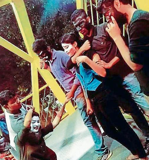 Students of St Joseph's College, Bengaluru, mobilising support for the gathering by staging mock scene of harassment of girls.