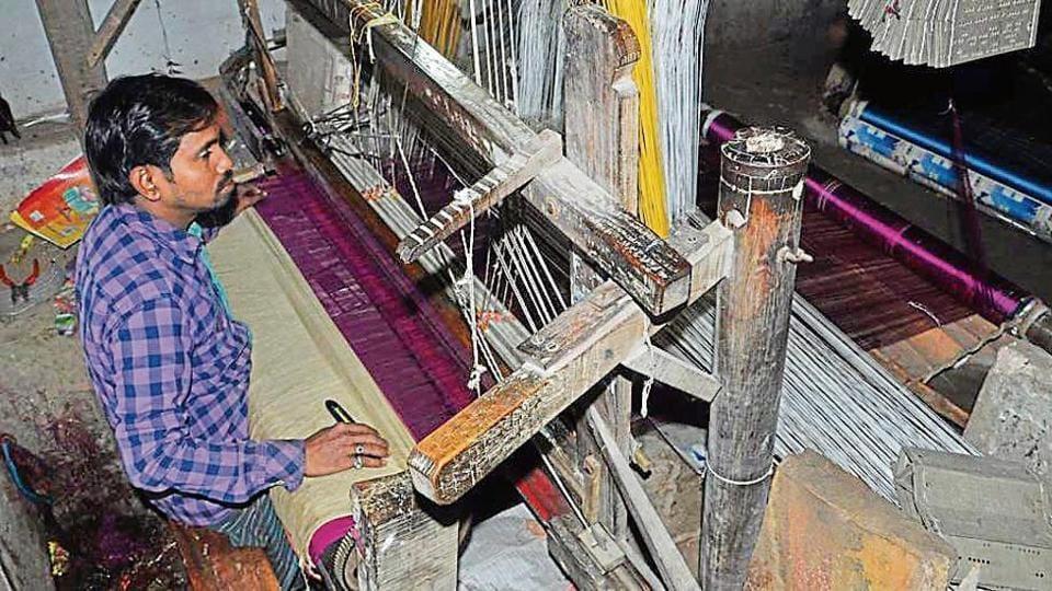 A young weaver at work in Varanasi.