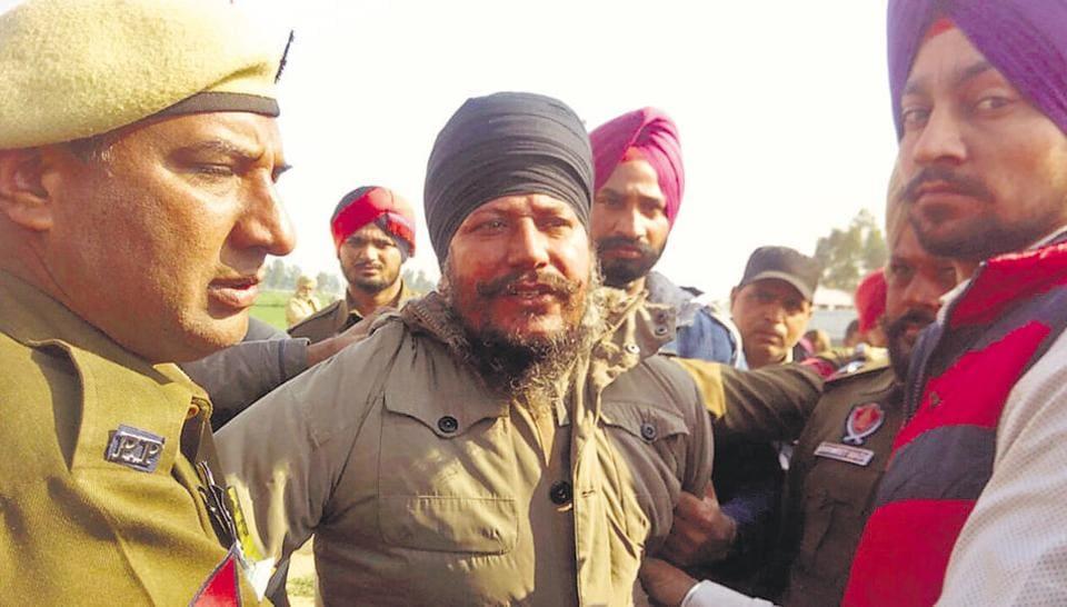 Gurbachan Singh, a relative of Sikh radical leader Amrik Singh Ajnala, in police custody after he hurled a shoe at Punjab CM Parkash Singh Badal at Ratta Khera village in Lambi segment.