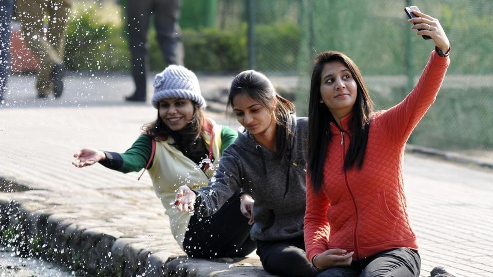 Girls at PUBotanical garden in Chandigarh on Wednesday.