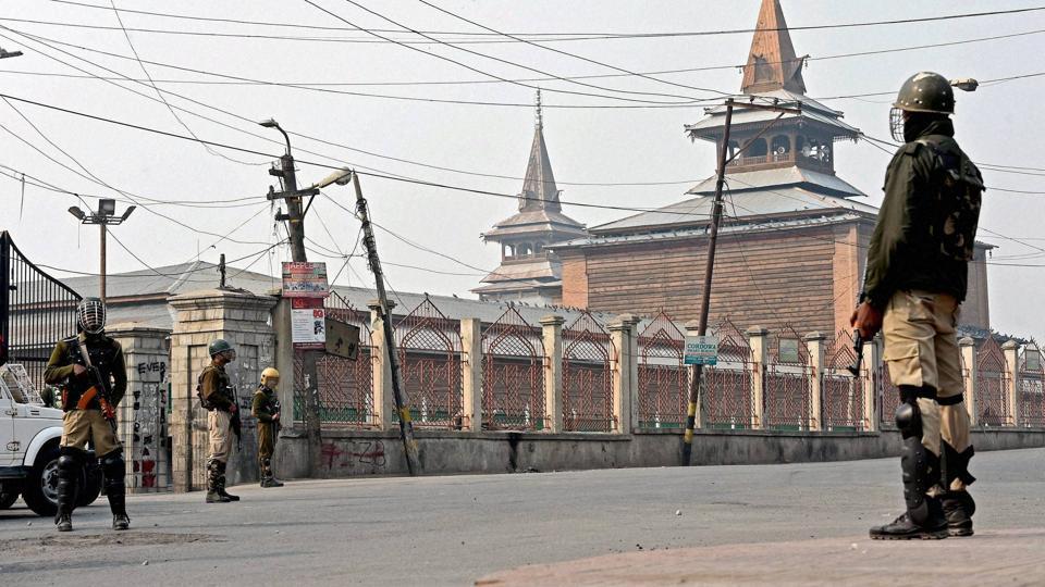 CRPF jawans stand guard during curfew outside Jamia Masjid in downtown Srinagar.