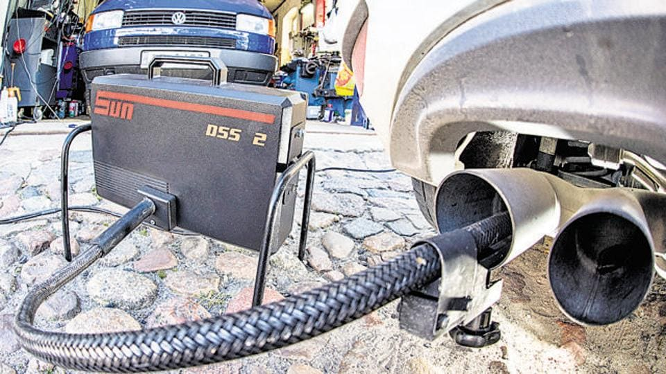 A measuring tube of emissions testing device for diesel-powered vehicles is attached to the exhaust pipe of a Volkswagen Golf 2.0 TDI in Germany.