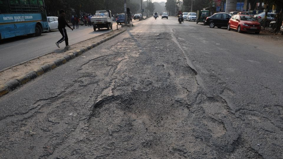 Potholes on Old Delhi-Gurgaon. MCG workers have been asked to repair all damaged road by July 15.