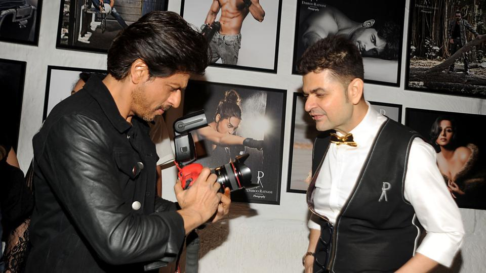 Shah Rukh Khan (L) poses with photographer Dabboo Ratnani as he attends the launch of the latter's 'Celebrity Calendar 2017' in Mumbai. (AFP)