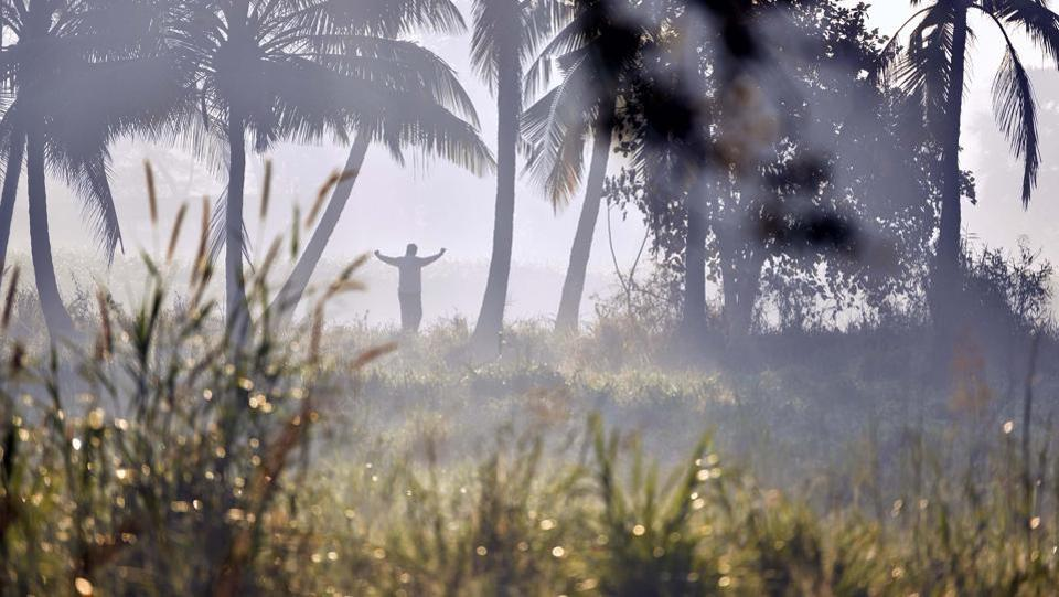 A man excercises in the fields at  Aarey Colony. (Pratham Gokhale/HT PHOTO)