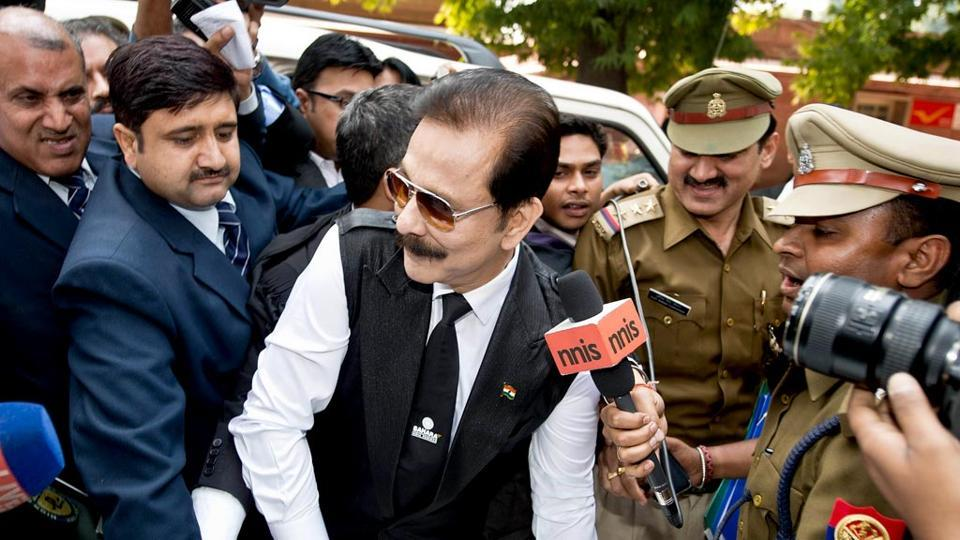 Security officials escort Sahara group chairman Subrata Roy at the Supreme Court in New Delhi.