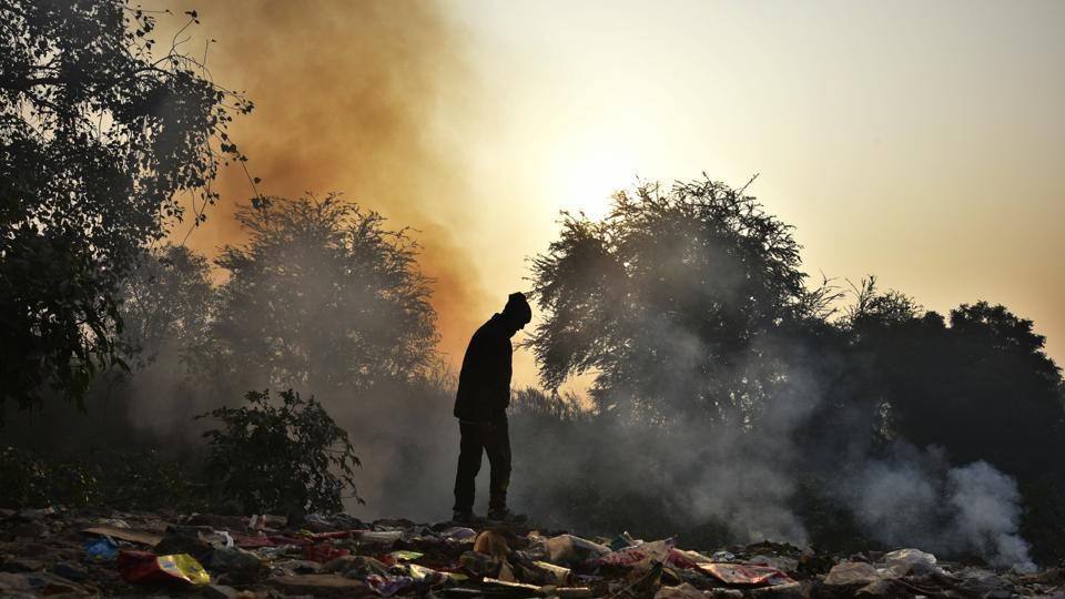 An East Delhi Municipal Corporation worker burns garbage in Gandhi Nagar on Thursday.  The East Delhi Municipal Corporation, which is the worst hit, has failed to conceive any big project for several years.