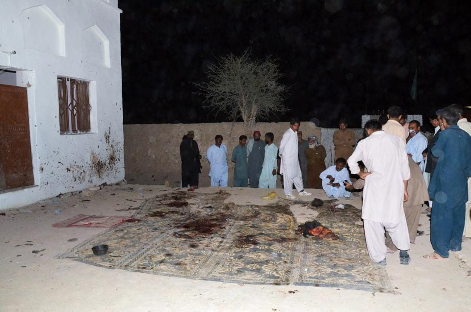 Shia Muslims at a mosque after a suicide bomb attack in the town of Chalgari in Baluchistan, 170 kilometres south east of Quetta, Pakistan, on October 22, 2015. 10 people including six children were killed.