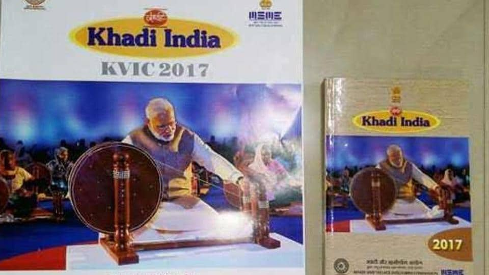The PM's photograph -- which was published on the cover pages of the Khadi Village Industries Commission's (KVIC) 2017 calendar and diary -- shows Modi weaving khadi on a large 'charkha', in the same classic pose as Gandhi.
