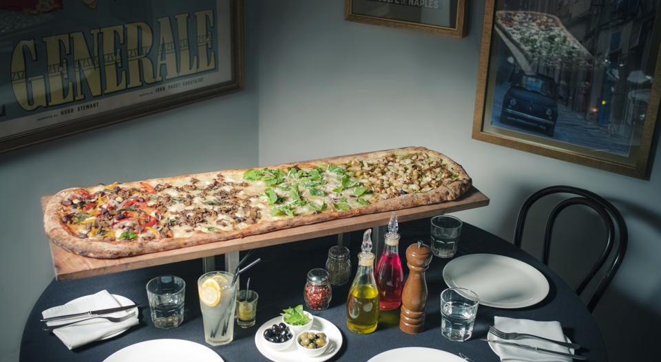 The rectangular 48-inch pizza at Gustoso is like four extra-large pizzas in one.