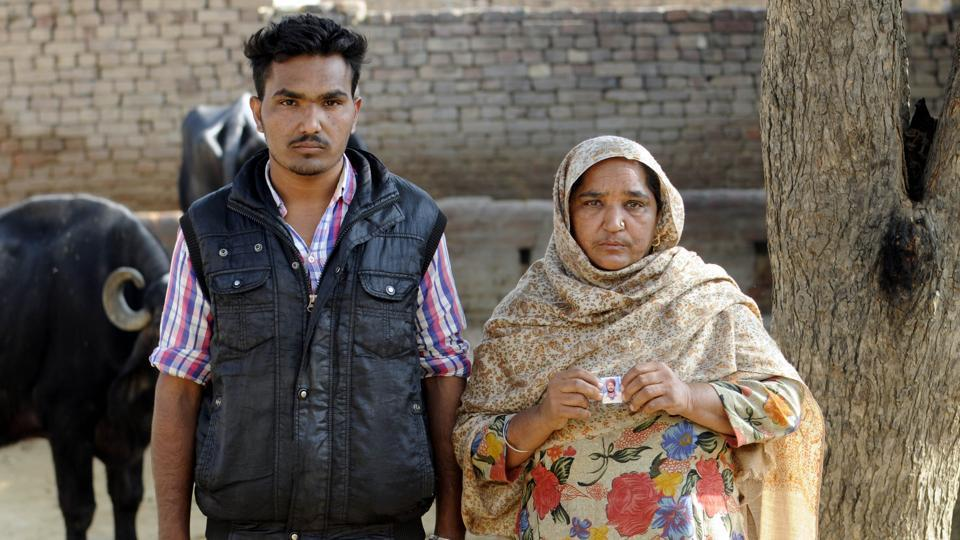 Gurpreet Singh and his mother at their home in Hamirgarh village. Gurpreet's father killed himself. He had a debt of Rs 4.5 lakh.