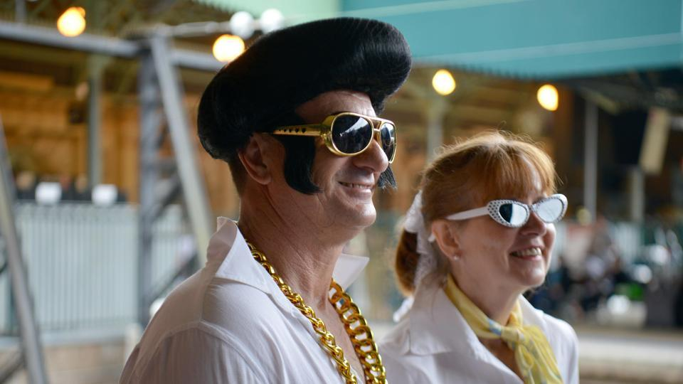 Elvis fans arrive at Central station to board a train to take them to The Parkes Elvis Festival from Sydney. The Parkes Elvis Festival is an annual event celebrating the music and life of Elvis Presley in the New South Wales town of Parkes.  (AFP)