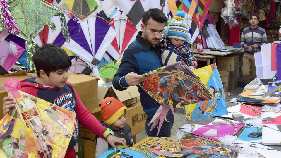 City resident selecting  kites on the occasion of Lohri festival in Amritsar on Friday. (Gurpreet Singh/HT Photo)