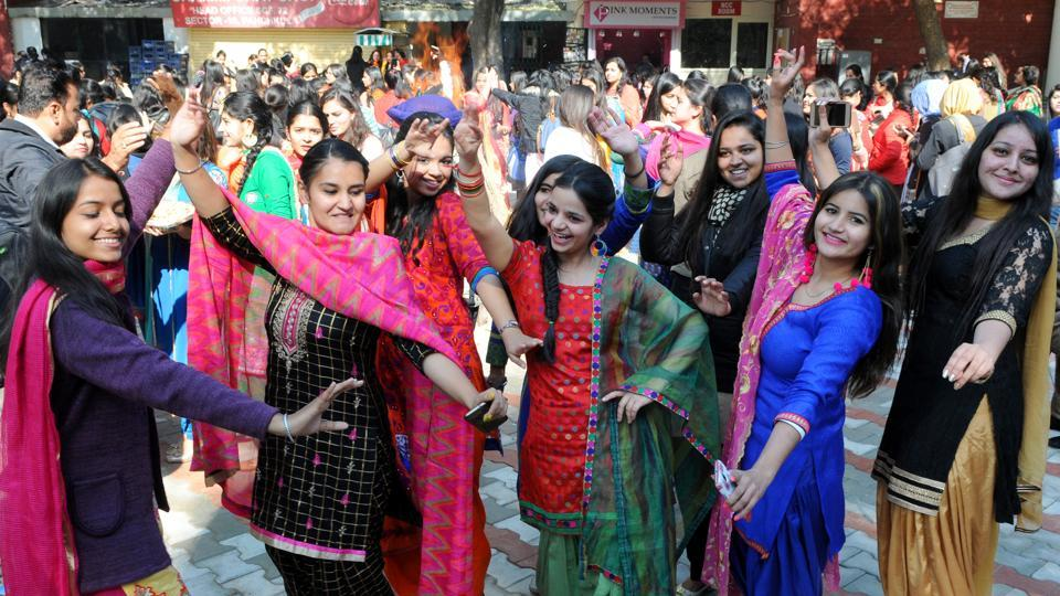 Girls celebrating Lohri festival at MCM College, Sector 36 in Chandigarh on Friday. (Anil Dayal/HT Photo)
