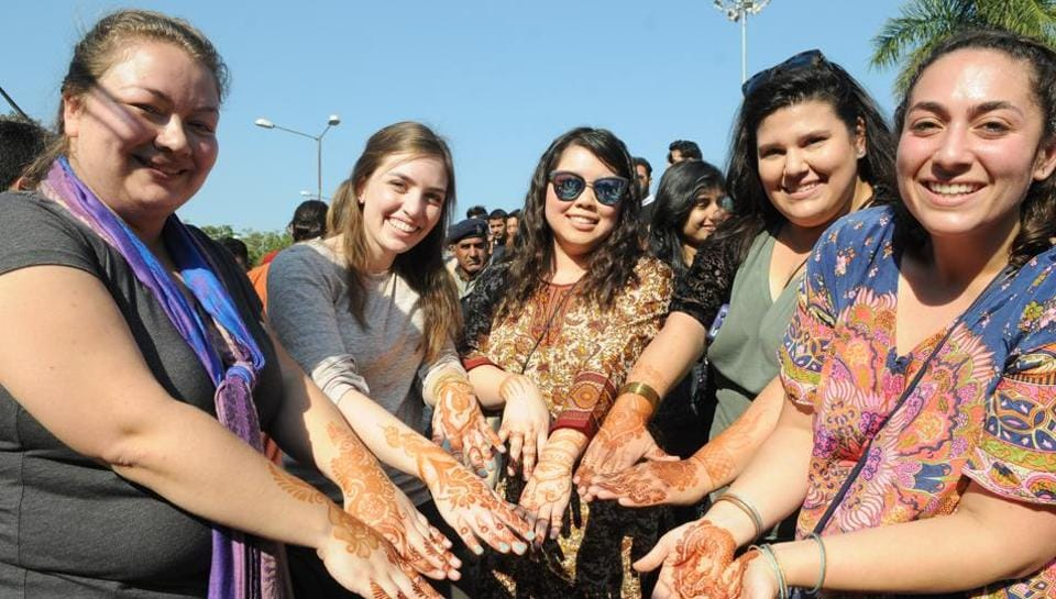 Tourist display henna decorations  on their hands during Lohri celebration at Panjab University in Chandigarh on Friday.  (Anil Dayal/HT Photo)