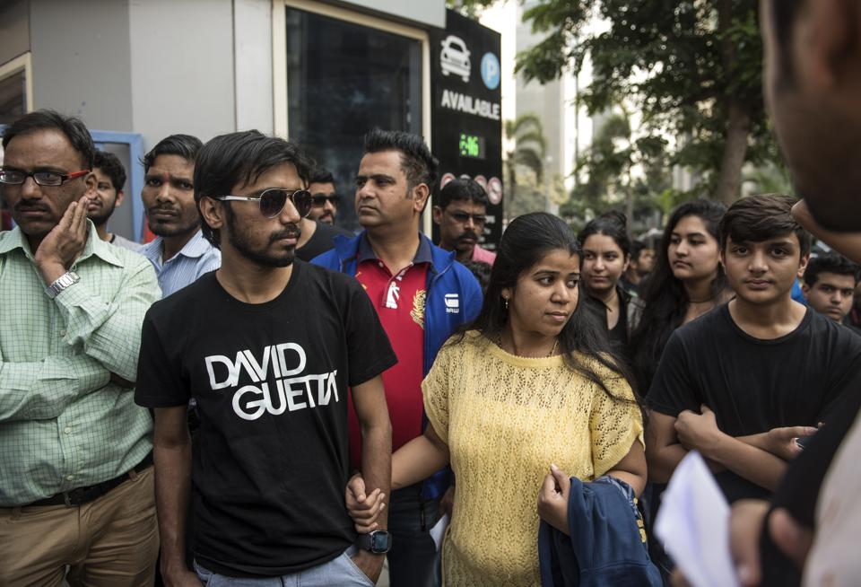 Fans stand at BKC Bandra to attend a David Guetta concert, which was cancelled after police denied permission for the event on Friday.