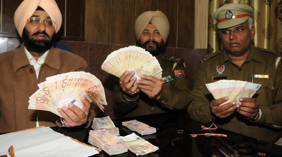 GRP officials showing seized Euros in Jalandhar on Thursday.