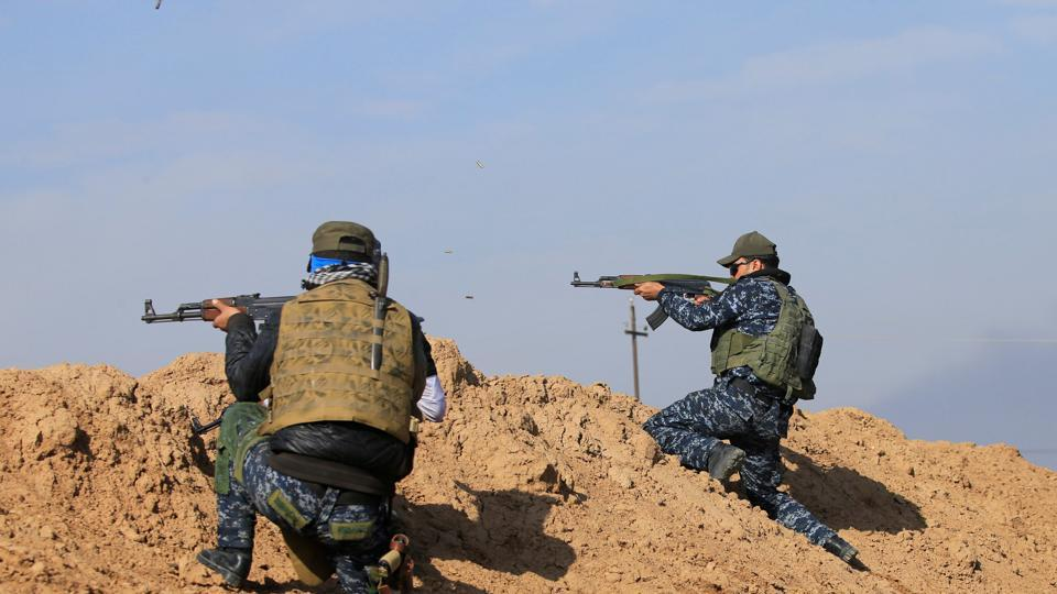 Iraqi Federal police fire during clashes with Islamic State militants, in the Sumer neighborhood of Mosul, Iraq, January 13, 2017.