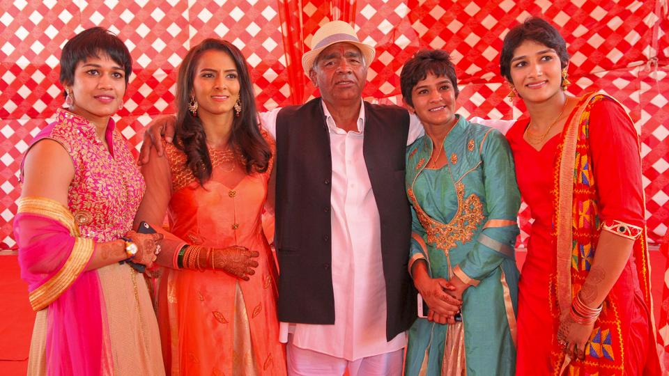 Mahavir Singh Phogat with his four daughters.