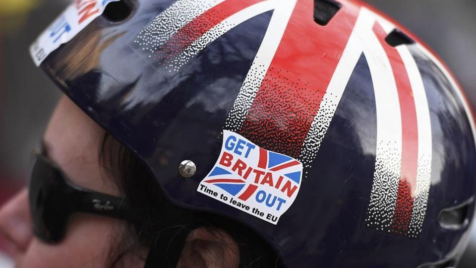 File photo of a cyclist wearing a pro-Brexit badge on her Union flag-themed helmet outside the Supreme Court in central London.