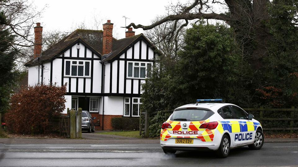 A police car drives past an address which has been linked by local media to former British intelligence officer Christopher Steele, who has been named as the author of an intelligence dossier on President-elect Donald Trump, in Wokingham, Britain.