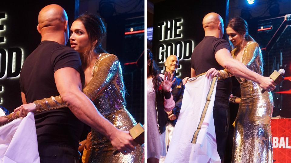When in India, do like the Indians. Deepika ties a lungi for Vin Diesel. (Prodip Guha/HT PHOTO)