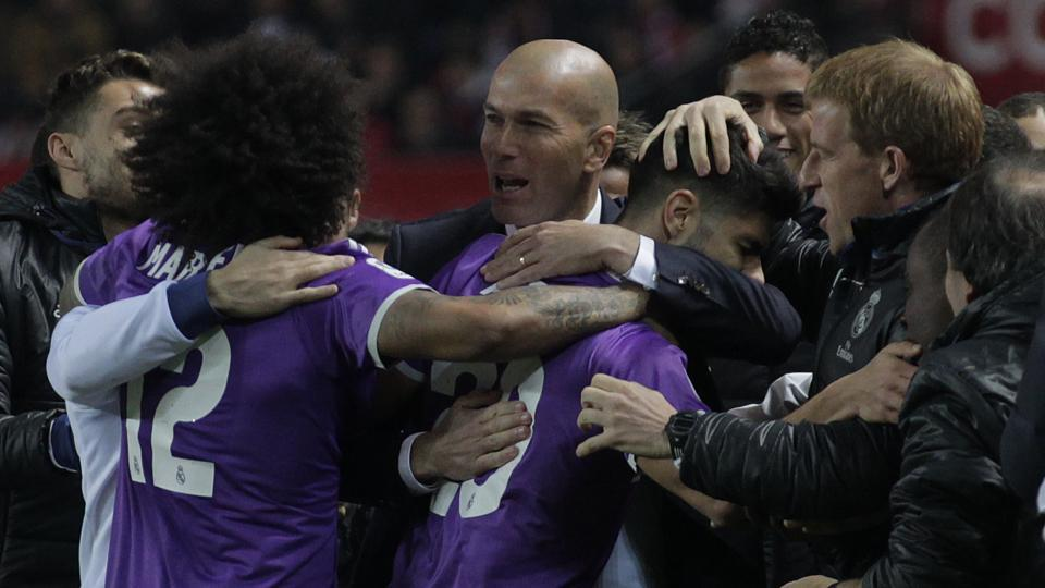 Real Madrid C.F. coach Zindeine Zidane celebrates Marco Asensio's goal with players during the Copa del Rey (King's Cup)match against Sevilla at the Ramon Sanchez Pizjuan Stadium on Thursday. Real won to set a Spanish record of 40 matches unbeaten.