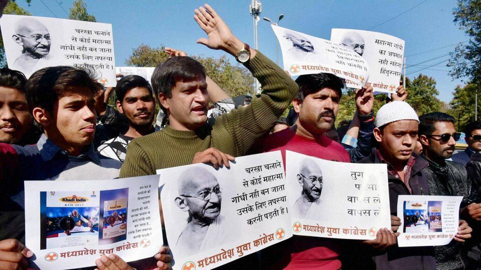 Youth Congress activists stage protest against removal of Mahatma Gandhi's photos from the Khadi Gramodhyog Board products, in Bhopal.