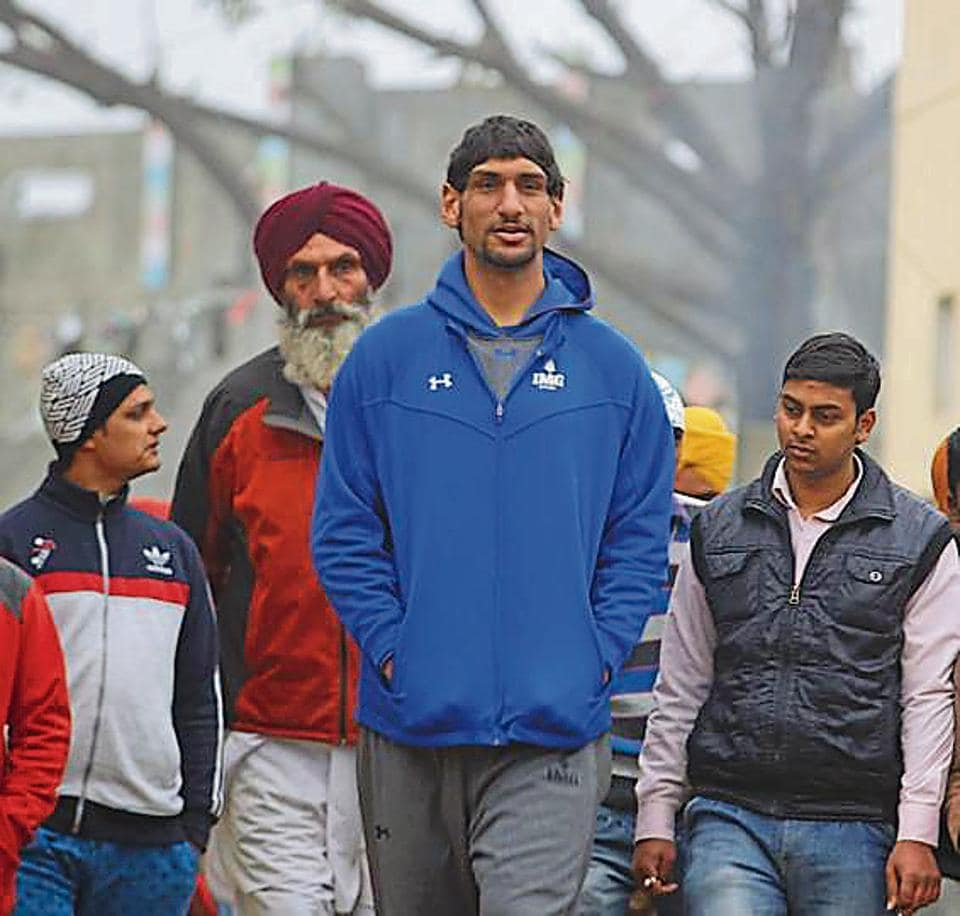 A new film, called One in a Billion, traces Satnam Singh Bhamara's journey. It opens with him returning to the village in Punjab where he grew up (above).