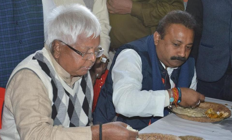 RJD chief Lalu Prasad and Bihar Congress president Ashok Choudhary at Makar Sankranti feat in Patna on Saturday. (A P Dube/HT Photo)