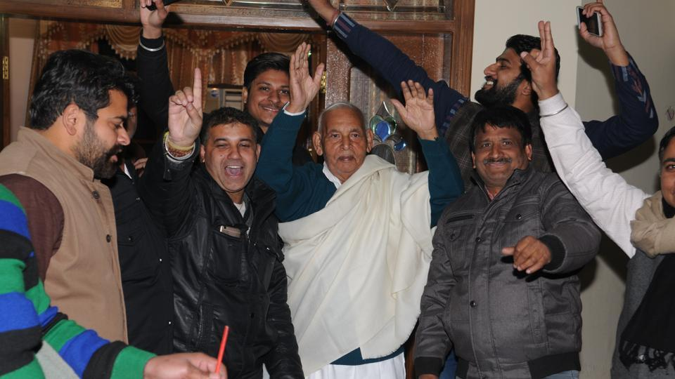 Former MLA Raj Kumar Gupta dancing with his supporters after getting the Congress ticket for Jalandhar North constituency on Friday.