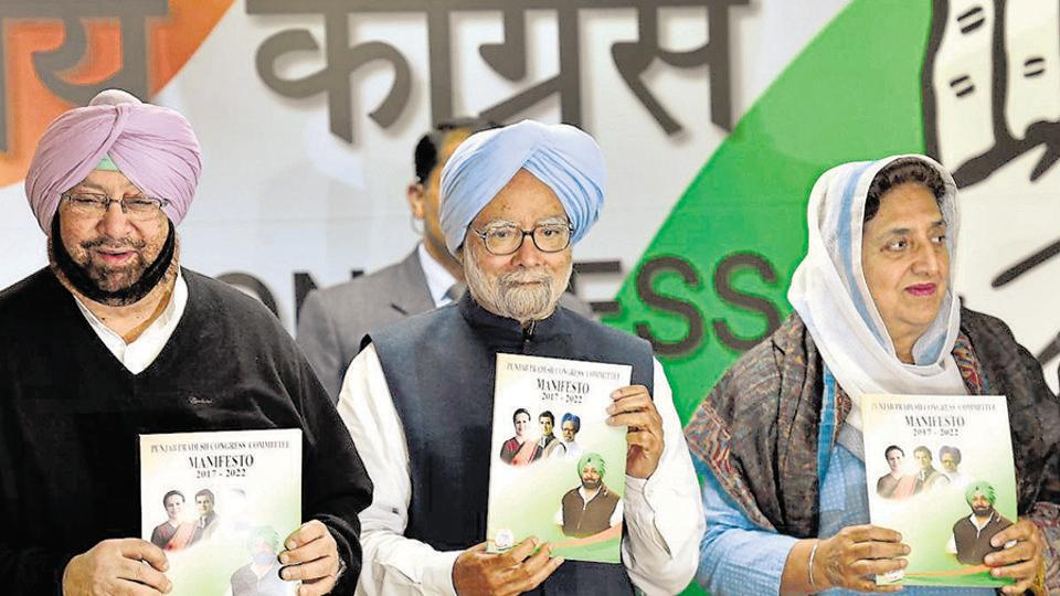Former Prime Minister Manmohan Singh along with Punjab Congress chief Captain Amarinder Singh and Rajinder Kaur Bhattal, release the Congress manifesto for  Punjab assembly elections, January 9, 2017.